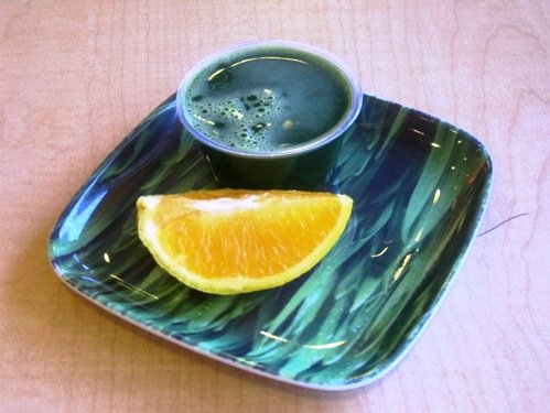 wheatgrass shot with orange